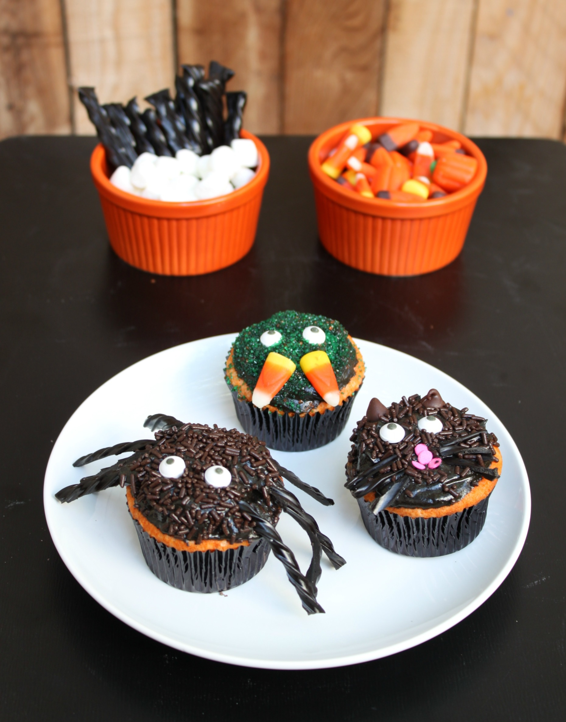 Creepy halloween cupcakes 52 kitchen adventures - Halloween decorations for cupcakes ...