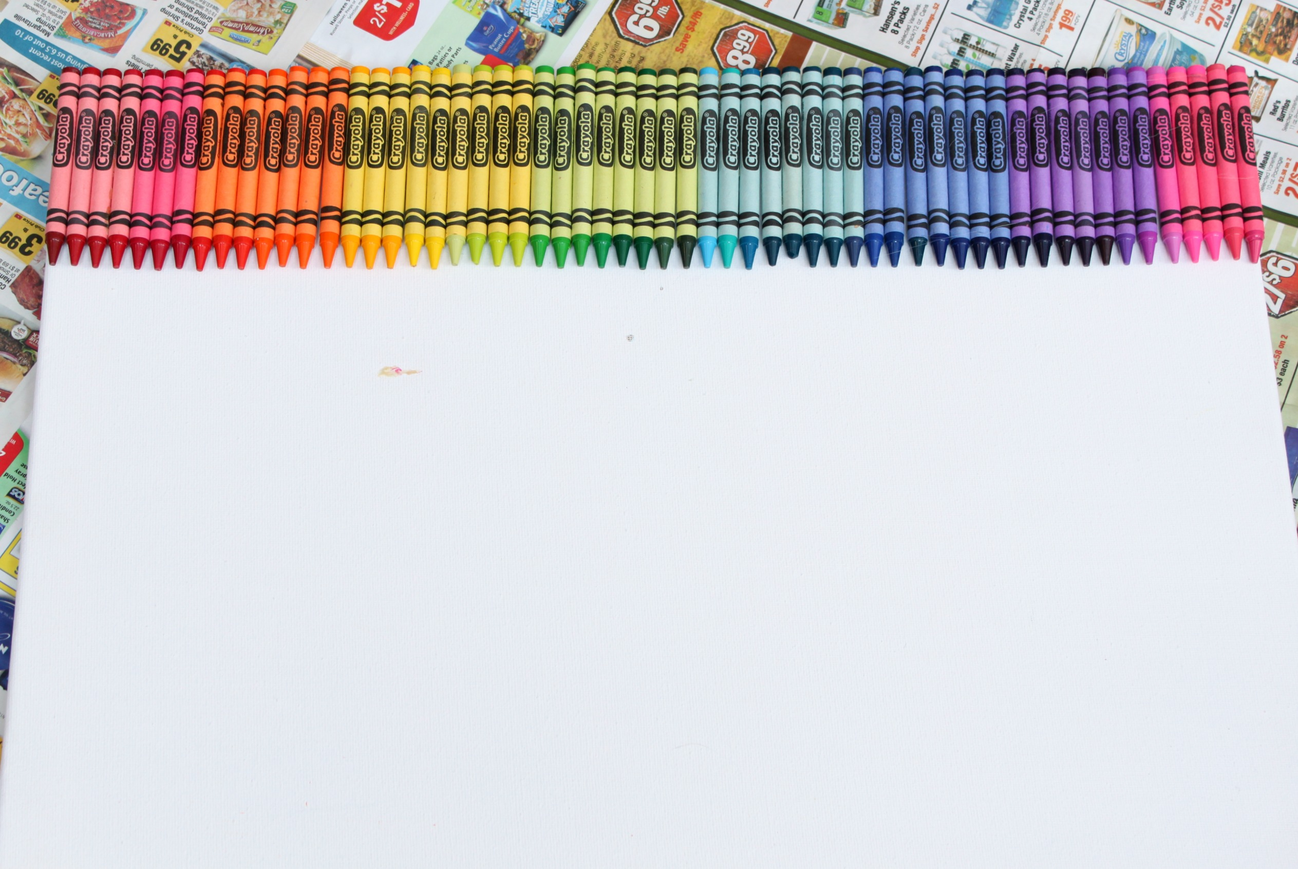 Line up and glue crayons to for How to melt crayons on canvas