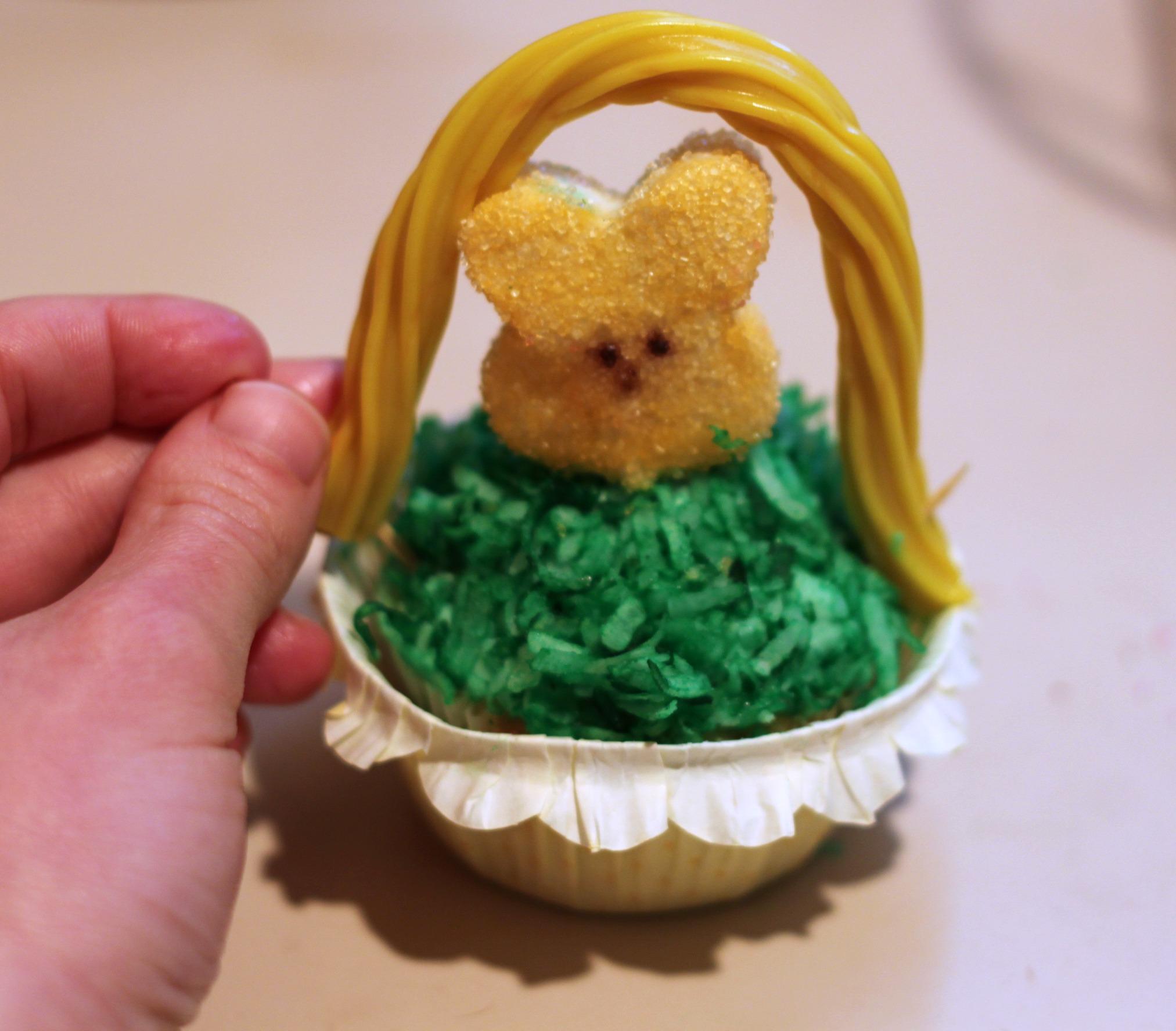 Put Twizzler onto Peepcake to make Easter basket cupcake