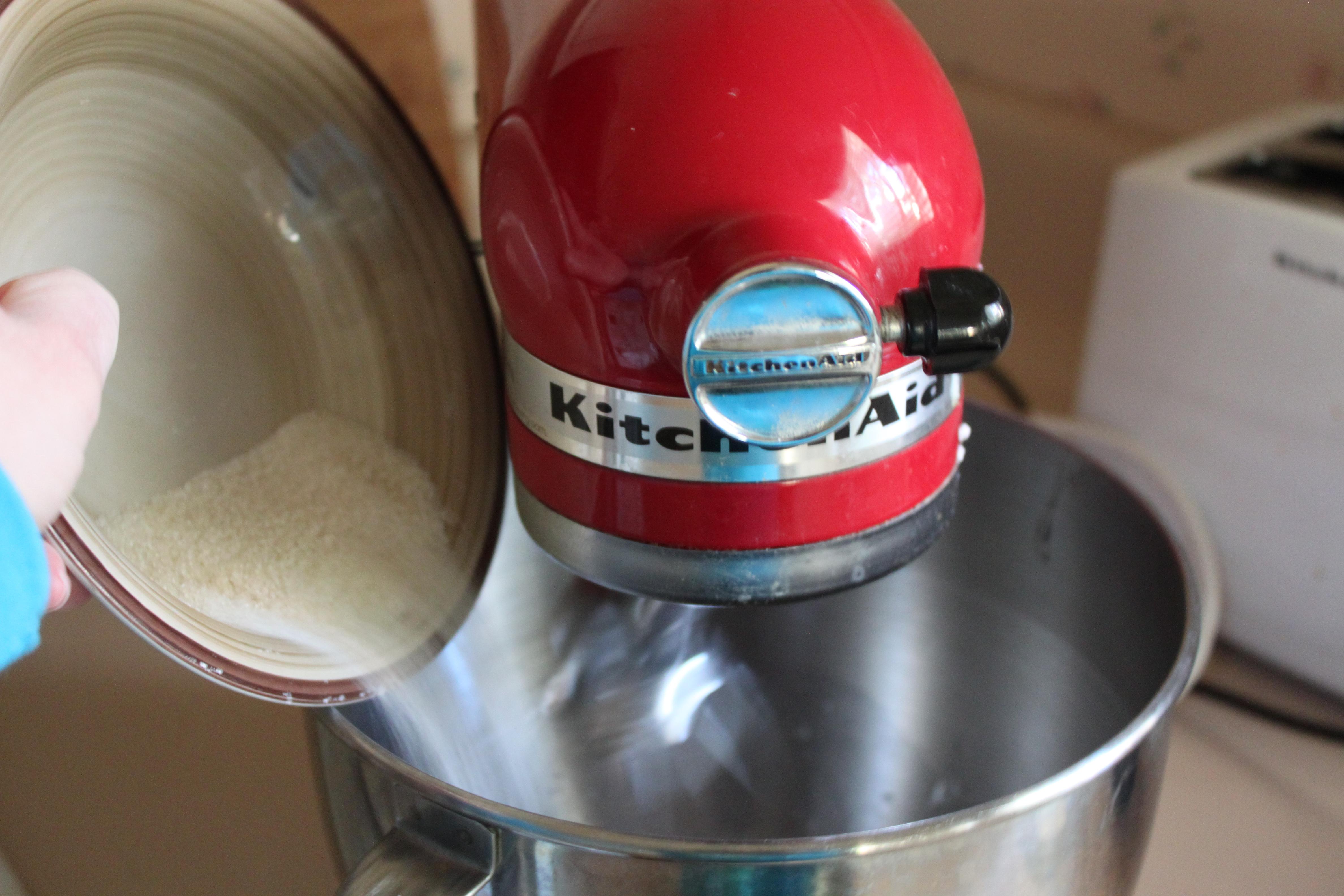 Add sugar to foamy egg whites