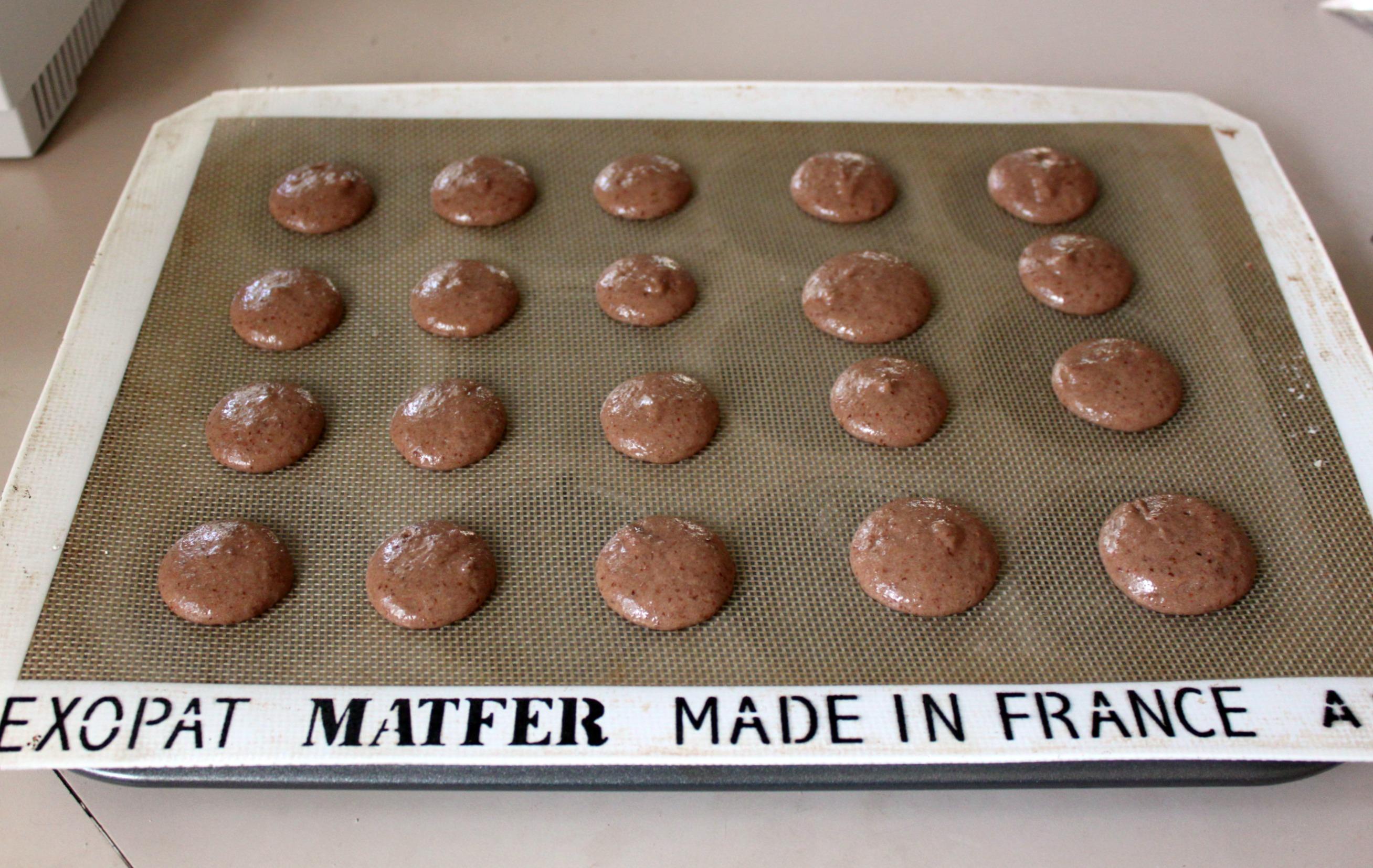 Pipe macaron batter onto prepared sheet